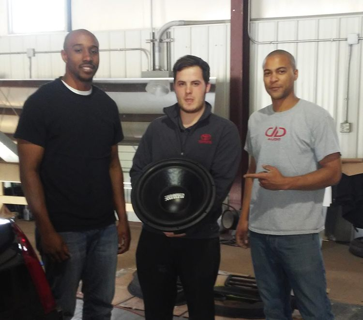 "Justice ""JAX"" Berry, Bryce Warner & Cameron ""Chimpo"" Powell with the 15"" Sundown Audio subwoofer Prize"
